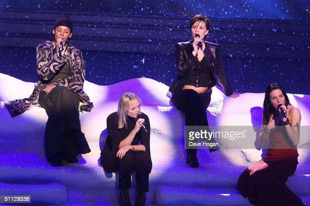 To R Singers Mel B, Emma Bunton, Victoria Adams and Mel C rehearse for the Royal Variety performance at the Dominion Theatre, London. Victoria shows...