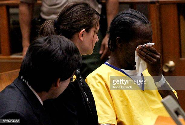 To R Stanford law students Gabriel Martinez and Reiko Rogozen listen with Gregory Taylor as he wipes away tears during a Habeas Corpus petition...