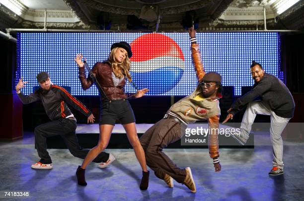 [L to R] Taboo Fergie william and apldeap of the Black Eyed Peas on stage Pepsi Co has announced an international partnership with multiplatinum hip...