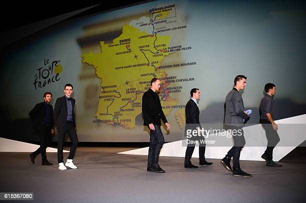 Thibaut Pinot Romain Bardet Chris Froome Richie Porte Julian Alaphilippe Adam Yates and Thomas Voeckler line up in front of the 2017 race route map...
