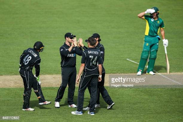 L to R Tom Latham Neil Broom Mitchell Santner and Dean Brownlie of New Zealand celebrate after taking the wicket of David Miller of South Africa...