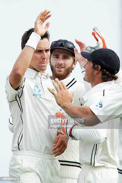 L to R Trent Boult of New Zealand celebrates with teammates Kane Williamson and BJ Watling after taking the wicket of Dimuth Karunaratne of Sri Lanka...