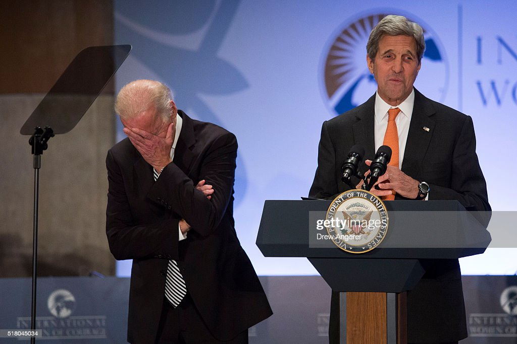 L to R, U.S. Vice President Joe Biden laughs as U.S. Secretary of State John Kerry introduces him to speak during the 2016 International Women of Courage Forum at the State Department, March 29, 2016 in Washington, DC. Established in 2007, the awards honor women around the world for leadership and courage in equality, social progress and human rights. Fourteen women were recognized this year.
