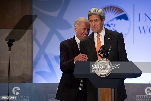L to R US Vice President Joe Biden laughs as US Secretary of State John Kerry introduces him to speak during the 2016 International Women of Courage...