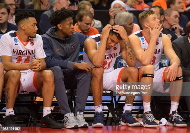 L to R Virginia's Marco Anthony De'Andre Hunter Isaiah Wilkins and Jack Salt in the final minute of the game during UMBC's upset of the University of...