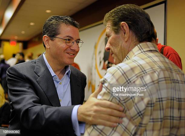 L to R Washington Redskins owner DAn Snyder has a word with offensive line coach Joe Bugel after he announced his retirement from NFL football today...