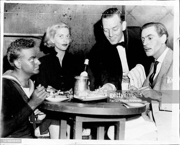 William Cole , Brigid Lenihan are served dinner by Laurence Sanderson Walter Sullivan . March 03, 1961. .
