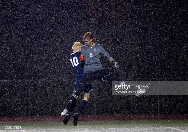 L to R Yarmouth's Jack Jones and Aaron Belesca celebrate at the end of the game as the rain comes down October 23 2018