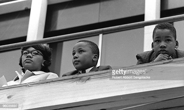 Yolanda King Martin Luther King III and Dexter Scott King children of Coretta Scott and Martin Luther King Jr listen to speeches during a rally...