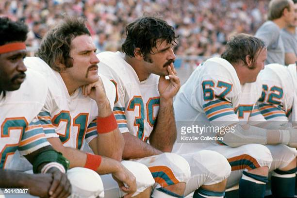 L to R0 Runningbacks Mercury Morris Jim Kiick and Larry Csonka of the Miami Dolphins on the bench during a game against the New England Patriots on...