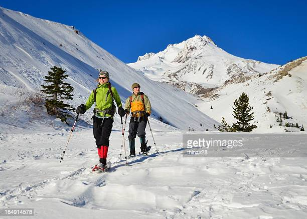 To snowshoers in the snow on a mountain