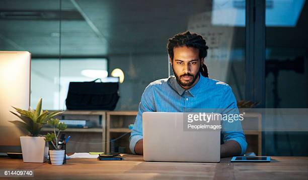 to stay productive you need to stay persistent - man in office stock photos and pictures