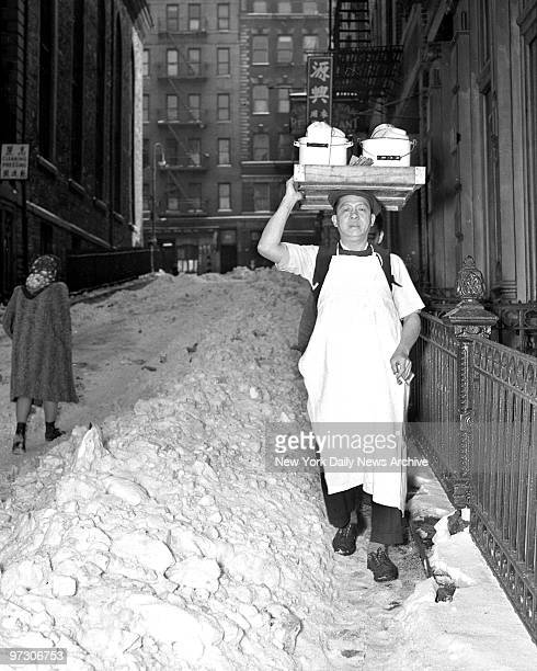 To the rescue of scores of stenogs marooned in downtown Manhattan offices by slushfiled streets went Wong Song Lee He brought them chop suey from 16...