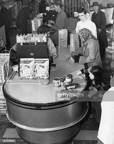 To the strains of soft music and jingling cash registers, customers thronged the new Busley Brothers supermarket, 3410 South Acoma street, Englewood,...