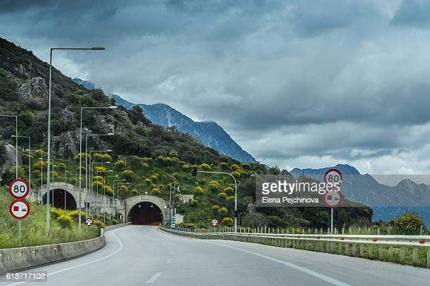 to the tunnels - speed limit sign stock photos and pictures