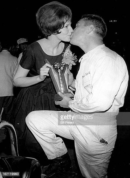 JUL 3 1964 To The Victor Belong Sandy Joanson Patricia Stevens model bestows a congratulatory kiss on Bob Wente of St Louis after his victory in USAC...