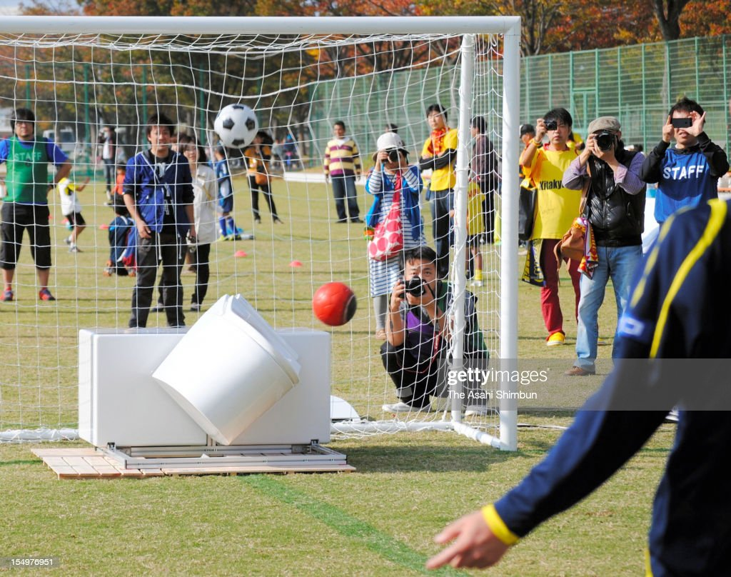 'TOTO To toto', also named 'Super Great Toilet Keeper' which projects a red ball to save the goal from a shoot by analysing vector and speed up to 100 mile-per-hour, concedes a goal during its launching event at Honjo Stadium on October 28, 2012 in Kitakyushu, Fukuoka, Japan. The toilet basin, developed by sanitary maker 'TOTO' in collaboration with sports lottery 'toto', only saved 10 percent of shots during the event.