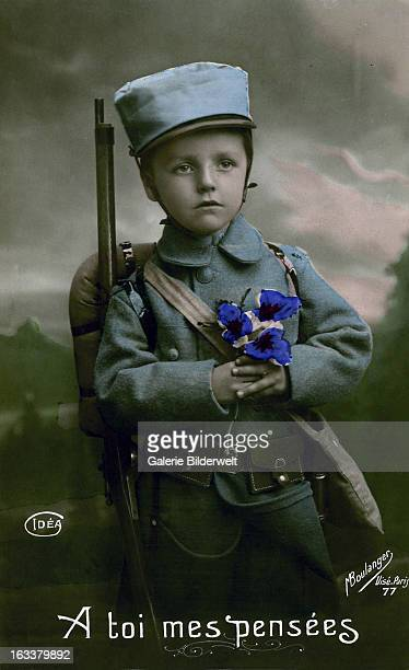 To you my thoughts1915 Studio photo of a boy in French uniform holding flowers Western Front World War I France Handcolored real photo postcard M...