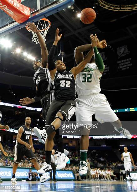 Toarlyn Fitzpatrick of the South Florida Bulls battles Vincent Council of the Providence Friars for a rebound during the game at the Tampa Bay Times...