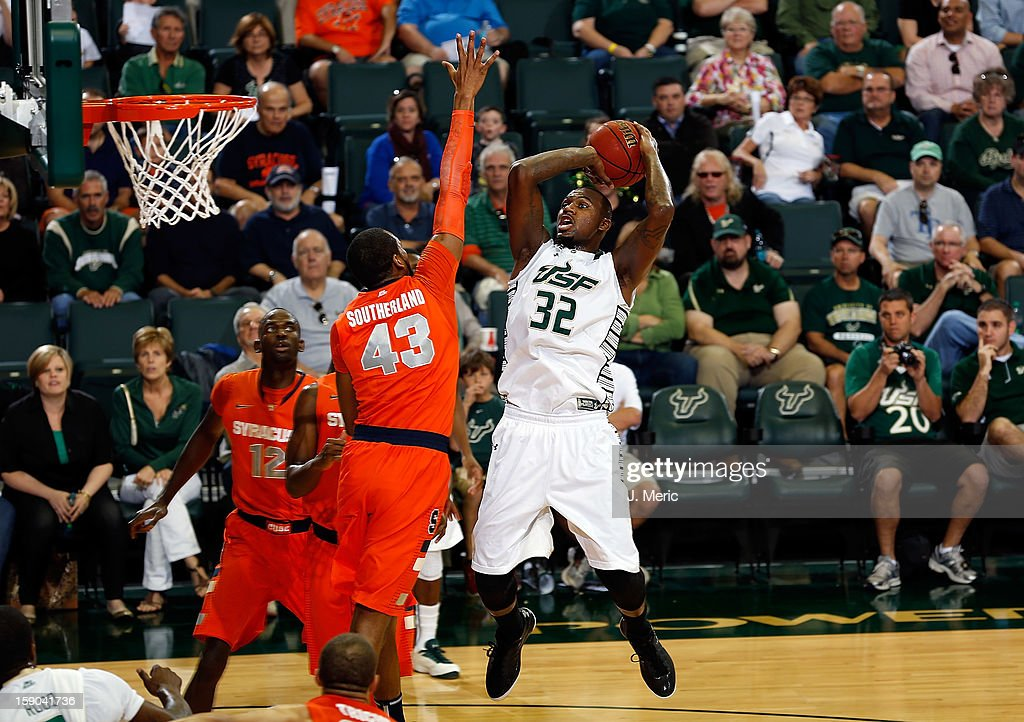 Toarlyn Fitzpatrick #32 of the South Florida Bulls shoots over James Southerland #43 of the Syracuse Orange during the game at the Sun Dome on January 6, 2013 in Tampa, Florida.