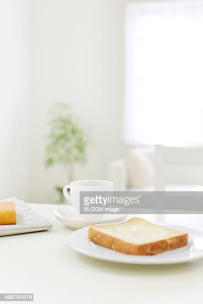Toast and cup of coffee on table