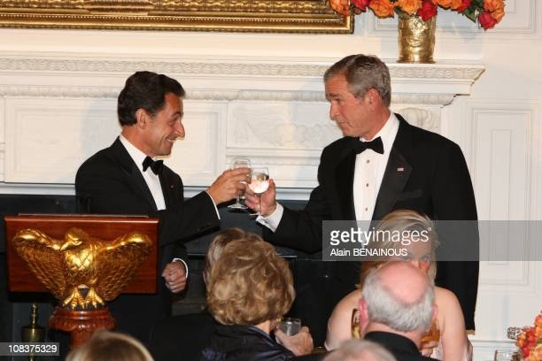 Toast between Nicolas Sarkozy and Georges Bush in Washington, United States on November 06th, 2007.