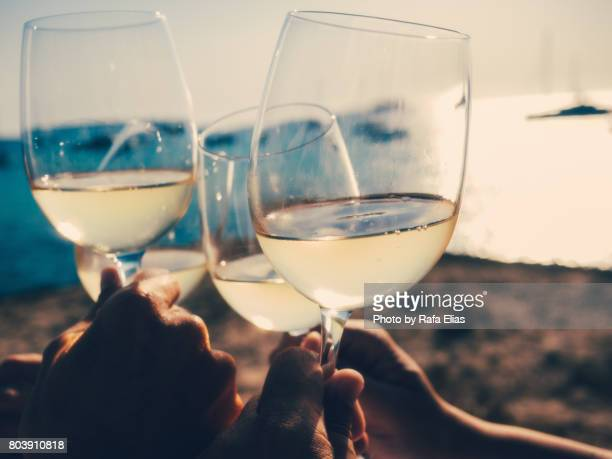 toast for three to the sea - white wine stock pictures, royalty-free photos & images