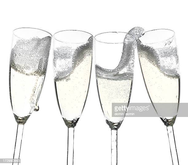 Toast! Four champagne glasses isolated on white