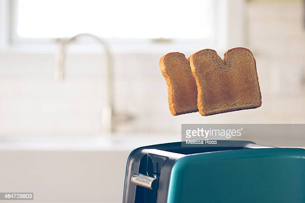Toast in mid-air popping up from a toaster