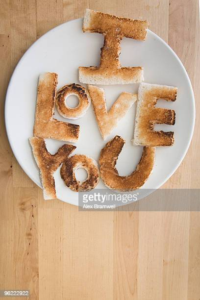 toast letters - love you stock photos and pictures