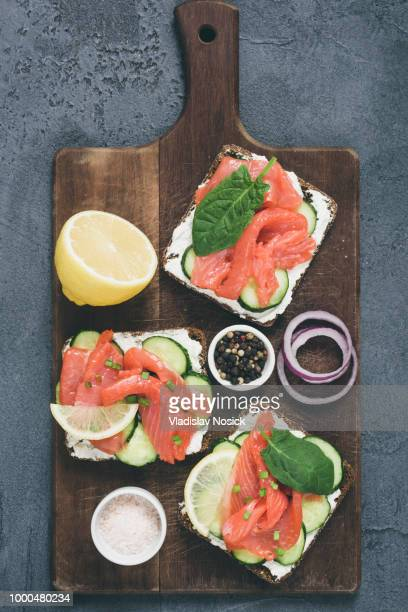 Toast sandwiches with salmon, cucumber and cream cheese