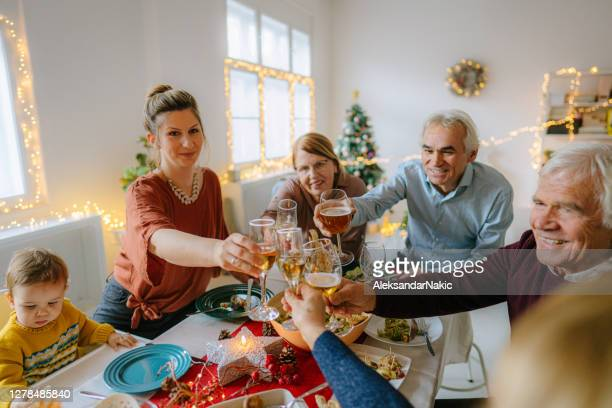 toast to a happy new year! - 70 year old man stock pictures, royalty-free photos & images