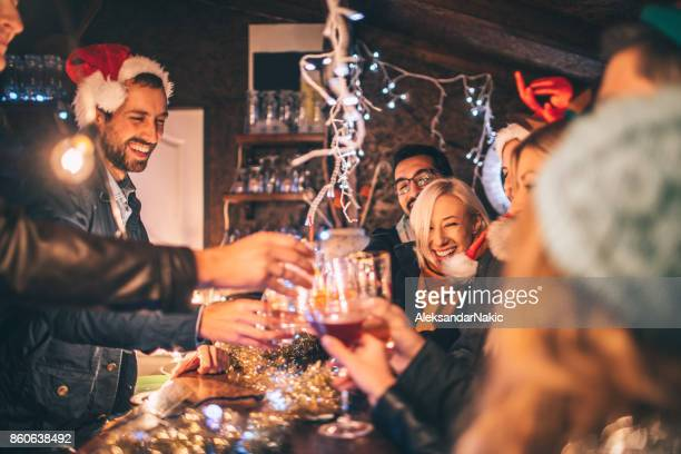 toast to a new year's - christmas party stock photos and pictures
