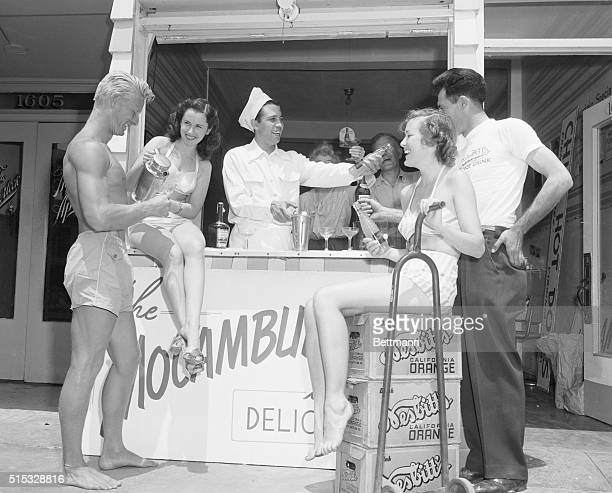 Toast to Sister Rita Santa Monica California Vernon Cansino brother of screen star Rita Hayworth serves drinks at his Santa Monica hot dog stand in...