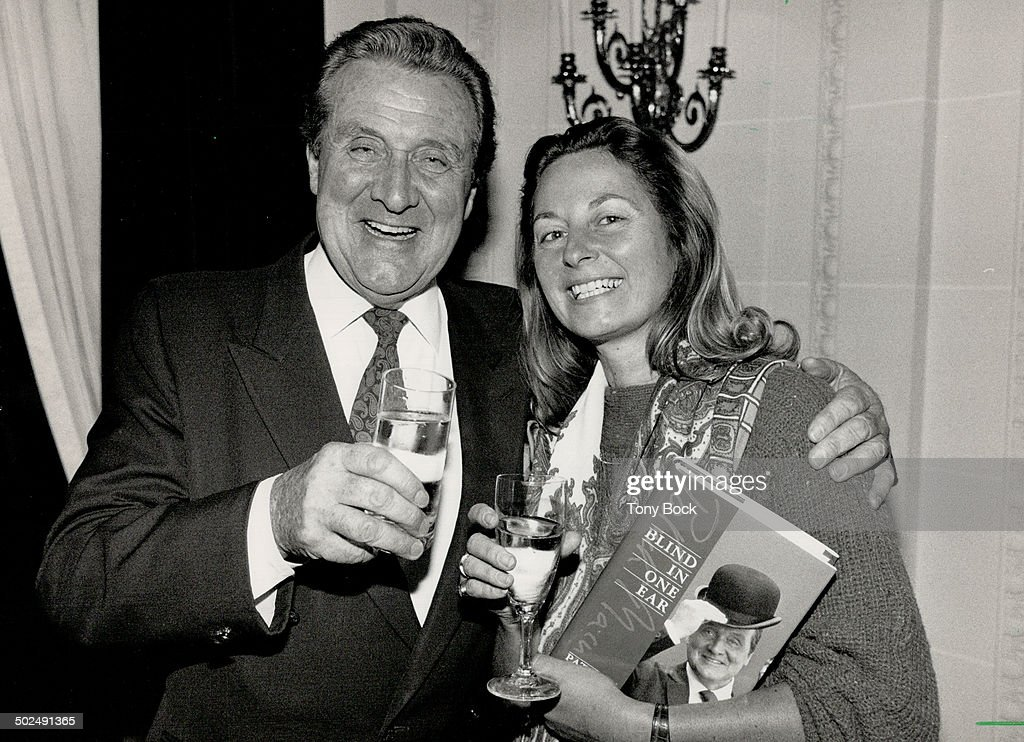 Toast to success: Patrick Macnee and publisher Anna Porter celebrates the launch of the actor's auto : News Photo