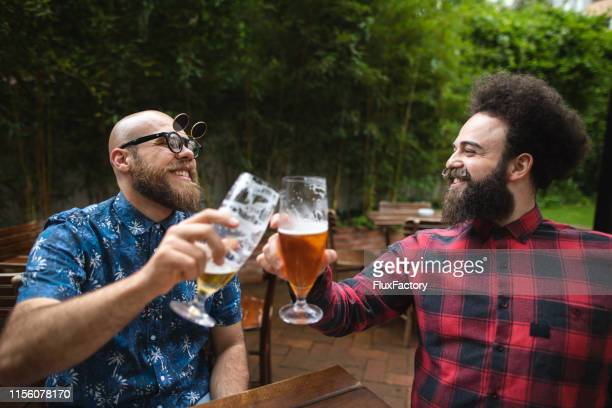 toast to the good times - best sunglasses for bald men stock pictures, royalty-free photos & images