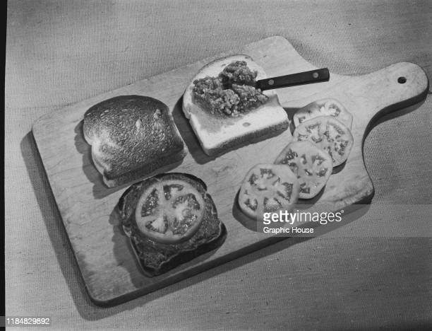 Toast topped with a relish and sliced tomatoes circa 1955