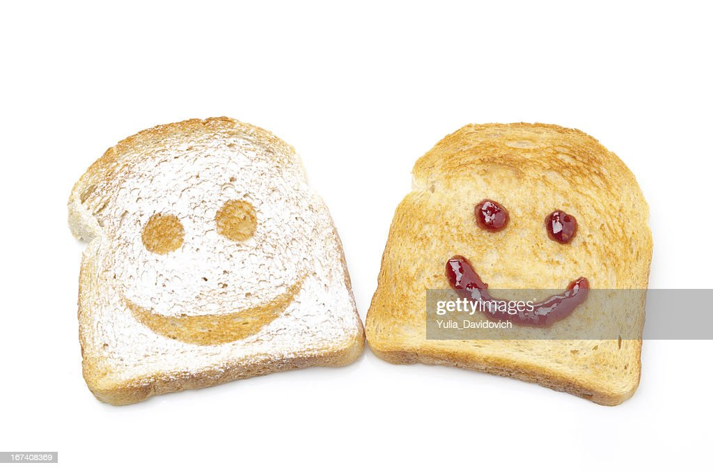 Toast with a smile of powdered sugar and jam isolated : Stock Photo