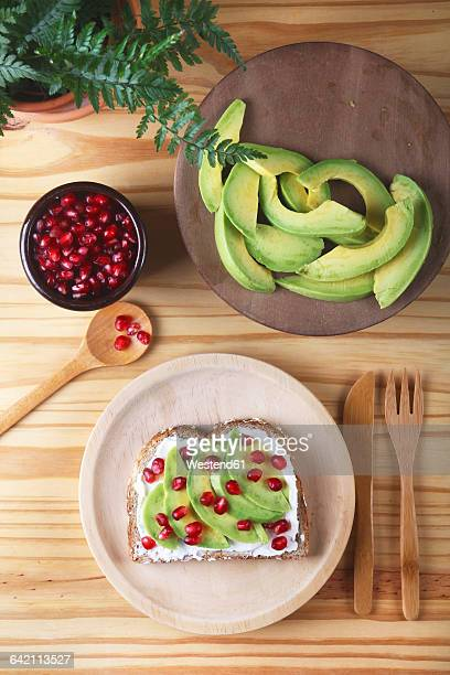 Toast with avocado, cream cheese and pomegranate seed