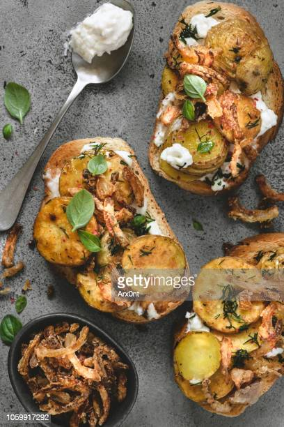 toast with cream cheese and potato - caviar stock photos and pictures