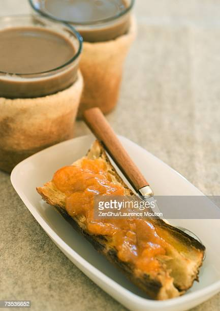 Toast with jam and two cups of coffee