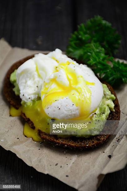 Toast with mashed avocado and poached egg