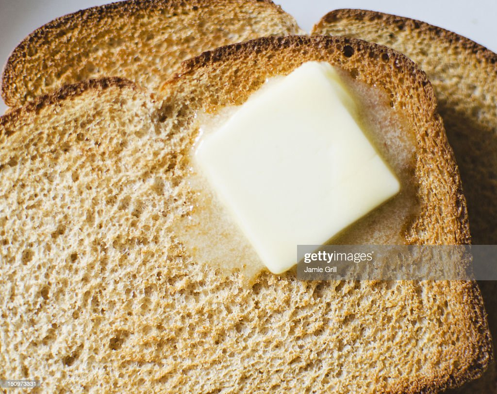 Toast with meltin butter : Stock Photo