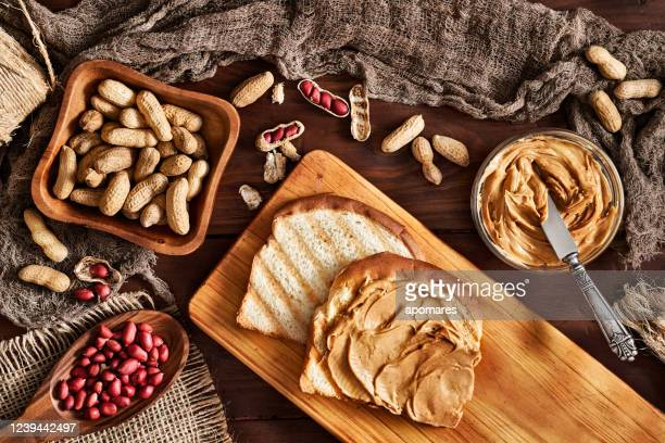 toast with peanut butter on vintage table set in rustic kitchen - peanut butter stock pictures, royalty-free photos & images