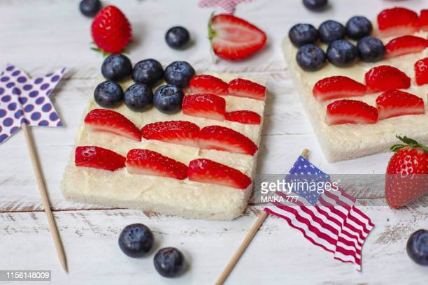 toast with the american flag made with butter, blueberries and strawberries. - july stock pictures, royalty-free photos & images