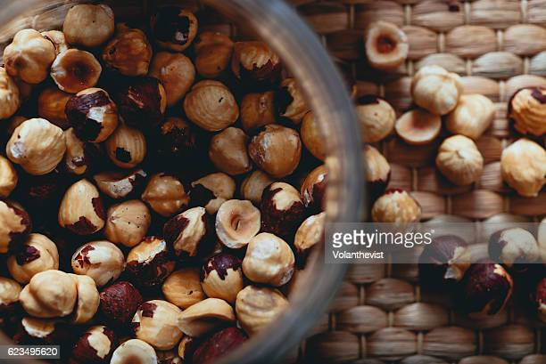 Toasted and peeled hazelnuts in a glass container