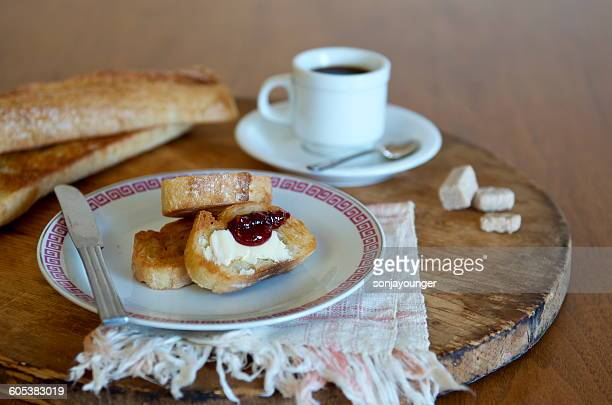 Toasted baguette and coffee breakfast