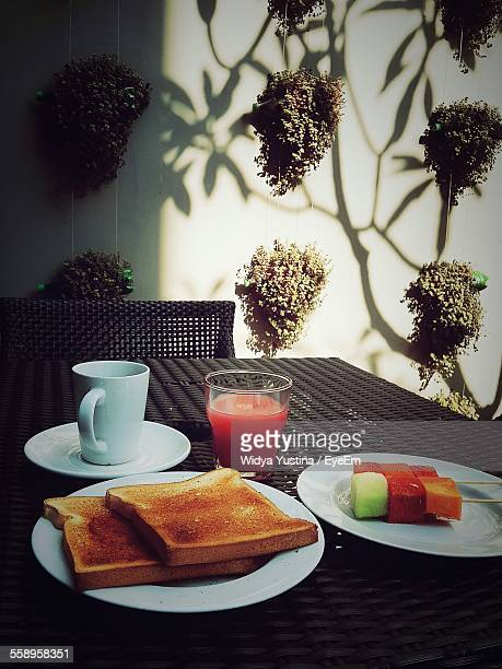 Toasted Bread And Grapefruit Juice On Table
