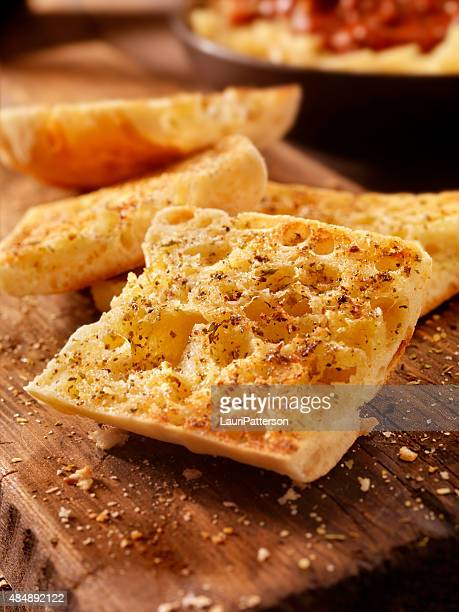 Toasted Garlic Ciabatta Bread on a Rustic Wood Cutting Board