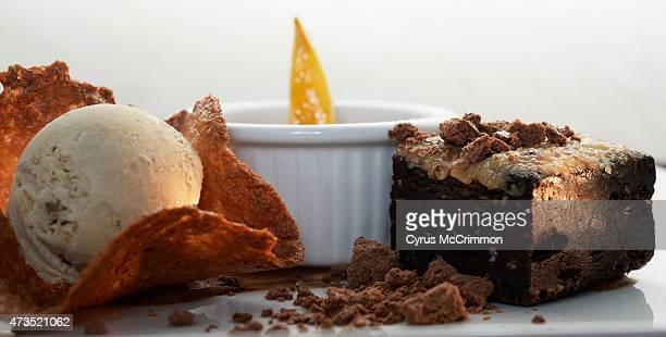 Toasted German chocolate flour less cake butterscotch creme brûlée candied lemon slice caramelia chocolate ganache coconut tuile cup and butter pecan...